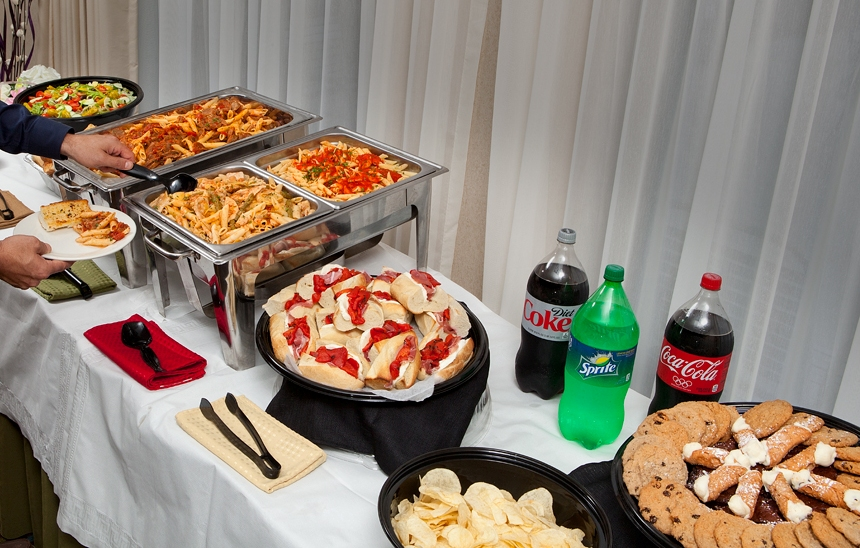 Catering-Man-At-Full-Banquet-Table-Reverse-cropped